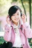 Young girl listen to the music Stock Image