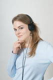 Young girl listen to music on headphone Royalty Free Stock Photo
