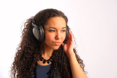 The young girl we listen to music in headphones Royalty Free Stock Image