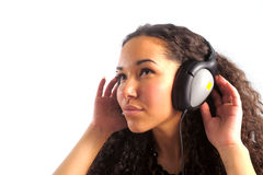 The young girl we listen to music in headphones Royalty Free Stock Photos
