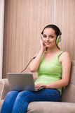 The young girl listening music at home Royalty Free Stock Images