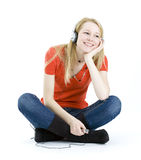 Young girl listening music from mp3 Stock Photos