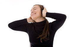 Young girl listening music from mp3 player Stock Images