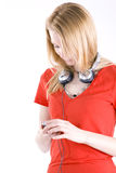 Young girl listening music from mp3 player. Stock Photo