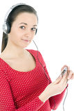 Young girl listening music from mp3 player Royalty Free Stock Photography