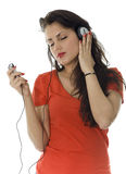 Young girl listening music from mp3 player Stock Photo