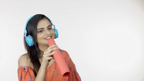 Young girl listening to her favorite song - using blue headphones - leisure concept
