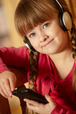 Young Girl Listening To MP3 Player Stock Photography