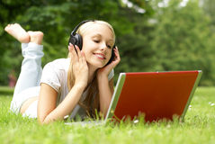 A young girl is listening to the music Royalty Free Stock Photos