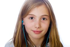 Young girl listening to music Stock Photography