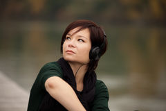 Young girl listening to the music Stock Images