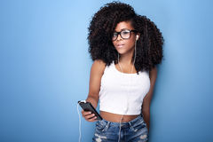 Young girl listening to music. stock photography