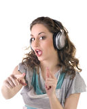 Young girl listening to music on headphones Stock Photo