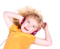 Young girl listening to music on headphones Royalty Free Stock Photos