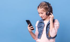Young girl listening to music with headphones Stock Photography