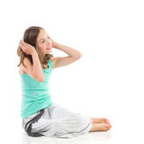 Young girl is listening to the music Royalty Free Stock Images