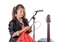 A young girl listening to music on his digital tablet Stock Photography