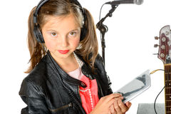 A young girl listening to music on his digital tablet Royalty Free Stock Photos