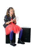A young girl listening to music on his phone Stock Photography