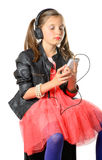 A young girl listening to music on his phone Stock Photo