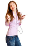 Young girl listening to music on mp3 player Stock Images