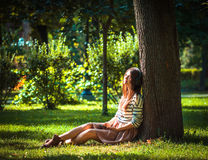 Young girl listening to music in park Royalty Free Stock Photo