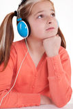 Young girl is listening to music Stock Photo