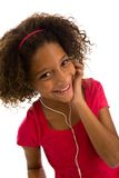 Young girl listening to music on portable device Stock Photo