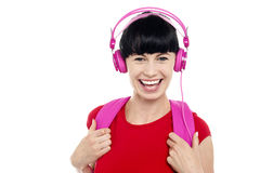 Young girl listening to music, using headphones Royalty Free Stock Photo