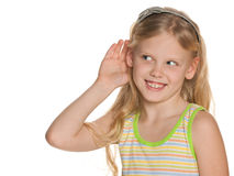 Young girl listening to something Stock Images