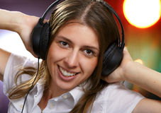 Young girl listens to music Royalty Free Stock Images
