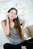 Young girl listens to music. A young girl listens to music Stock Photo