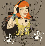 The young girl listens to music in headphone Royalty Free Stock Image