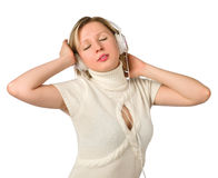Young girl listens to music on headphones Royalty Free Stock Images