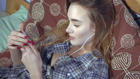 Young girl listens to music with headphones stock video footage