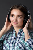 Young girl listens to music with headphones Royalty Free Stock Photo