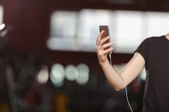 A young girl listens to the music in a gym royalty free stock photos