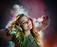 Young girl listens to music Stock Images
