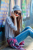 Young Girl Listens to Music in White Headphones Royalty Free Stock Images
