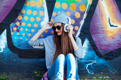Young Girl Listens to Music in White Headphones Stock Images