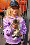 Young girl with little kitten Royalty Free Stock Image