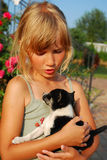 Young girl with little puppy Stock Photography