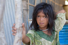 A young girl lives in a fishing village and tourist poses for a Stock Photos