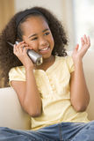 Young girl in living room using telephone royalty free stock photo