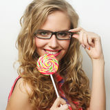 Young girl with lolipop Stock Images