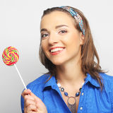 Young girl with lolipop Royalty Free Stock Images