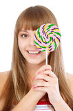 Young girl and lollipop Royalty Free Stock Photography