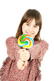 Young girl with lollipop Stock Images