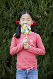 Young girl and a lollipop Stock Image