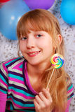 Young girl with lollipop Royalty Free Stock Photography